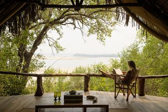 Tanzania - reading on safari - SandRivers Nomad.jpg