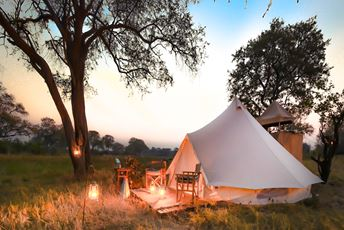Botswana Feline Fields Khwai camp tent with fire.jpg