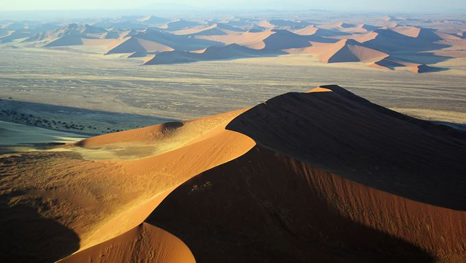 Aerial flying safari in Namibia's Namib desert above dunes