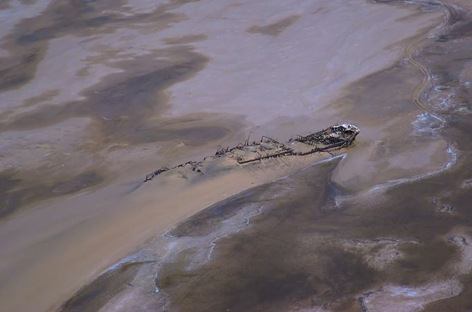 Namibia's skeleton coast aerial view of shipwreck during flying safari
