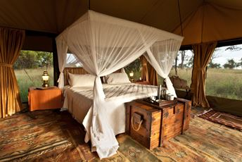 View of bedroom in private tented camp set up to see Great Migration