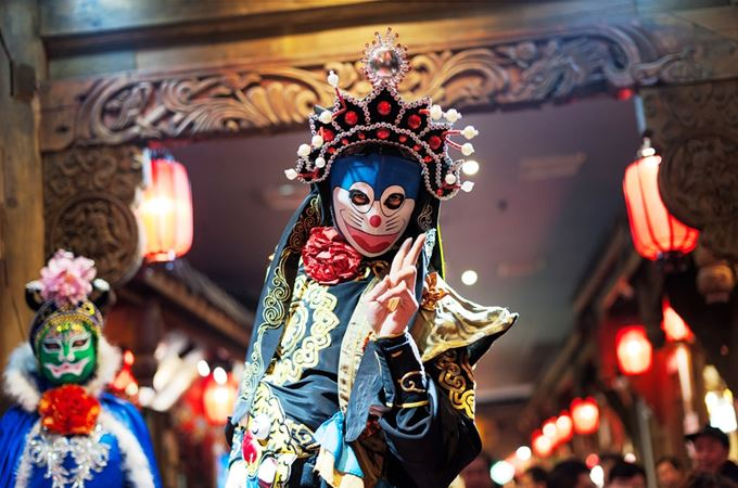 China - Sichuan Opera - performer in colourful dress and mask