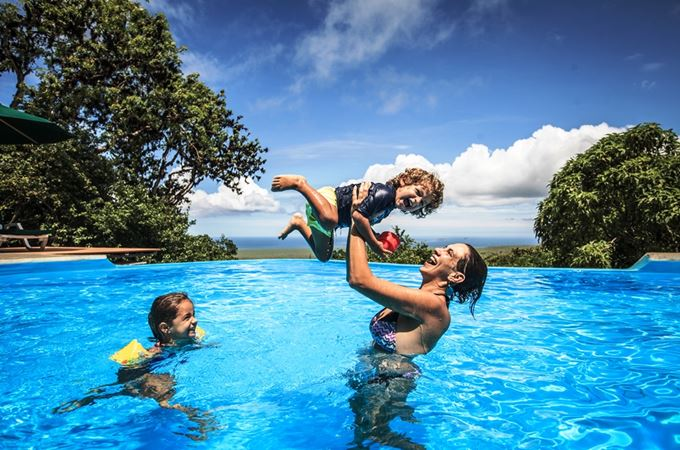 Latin America-Ecuador-Galapagos Islands-Family playing in Pool-Galapagos Safari Camp.jpg