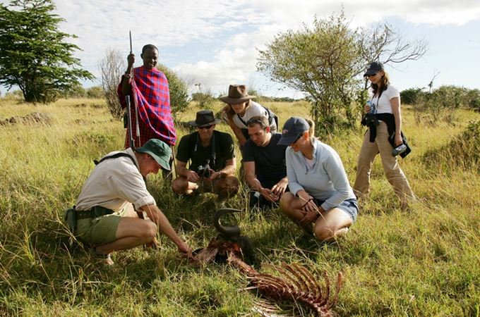 Menya guide with family showing dean animal remains.jpg