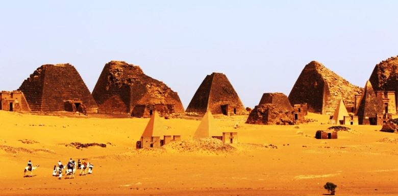 7 Africa, Sudan, Meroe, Royal Cemetery of Meroe pyramids with camels.jpg