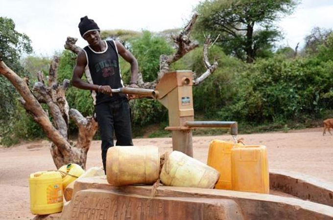 Wasya Wa Athi B self-help group southeast Kenya pumps clean water.jpg