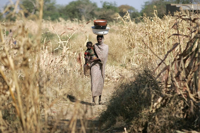 A woman with her child in their village near Goz Beida, Chad, Africa