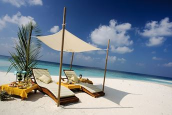 Maldives Beach chairs under pergola.jpg