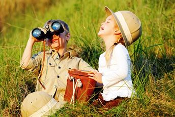 Young children with safari hats in tall grass.jpg