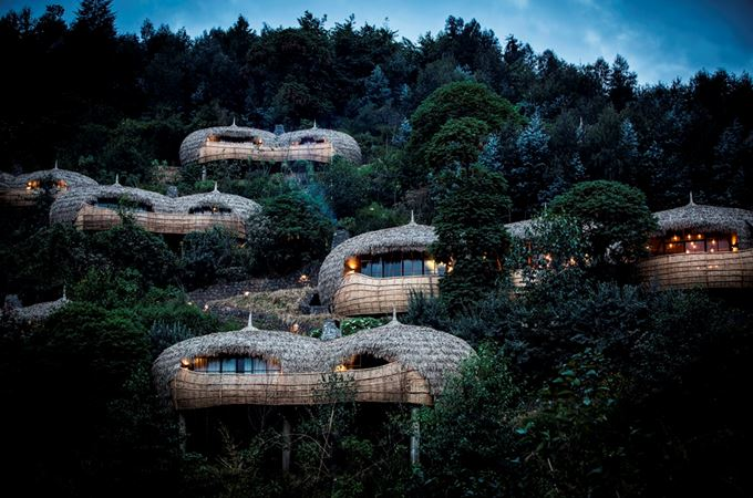 Bisate lodge rooms over a hillside on a Rwanda Gorilla Trekking and flying safari