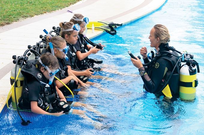 Children learning to dive at the PADI school at Blue Safaris in the Seychelles