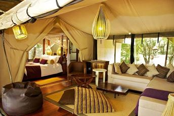 Kenya - Mara Intrepids - Interior of tent with lounge and bedroom view.jpg