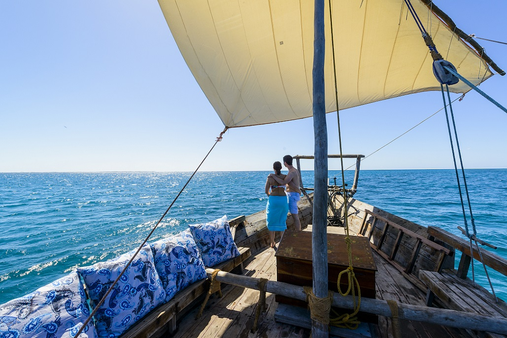 Mozambique dhow sailing - couple on board dhow.jpg