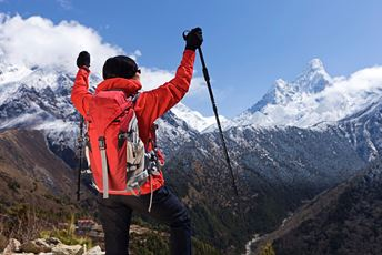 Nepal - trekking in the Himalayas - walker overlooking valley - istock.jpg