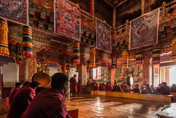 Bhutan - Gangtey Lodge - Buddhist monastery prayers - Ken Spence.jpg